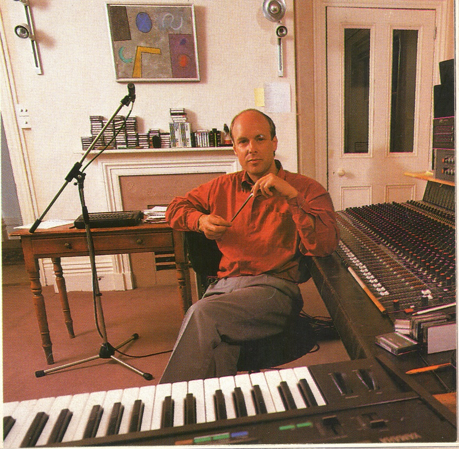 Brian Eno in his studio in 1990 with a Colin Thoms on display